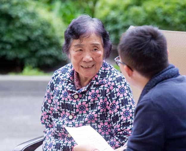 Elderly asian woman talking with asian man