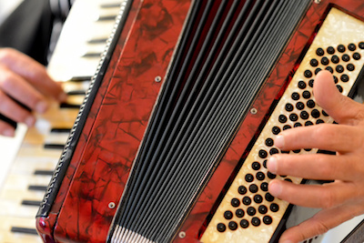 photo of person playing accordion