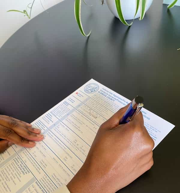 Filling out a voter registration card