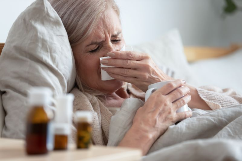 Older Woman Sick in Bed